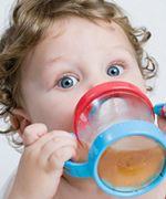 Child Holding a Sippy Cup